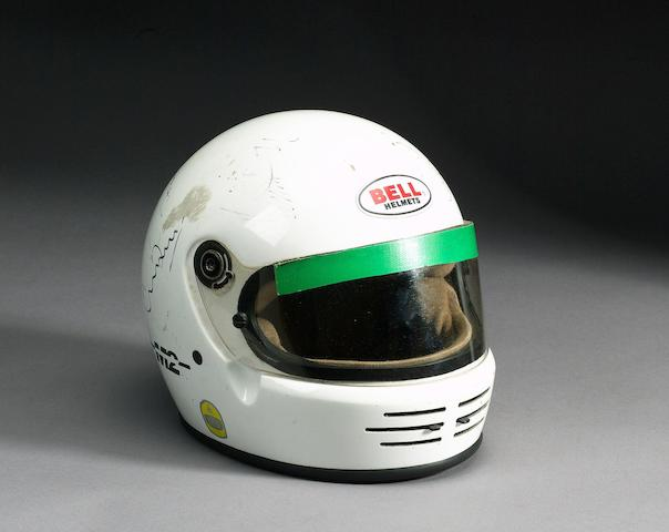 A Bell helmet signed by nine drivers and team members,