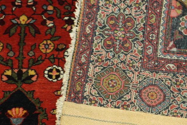 A Kashan rug 200cm x 126cm.