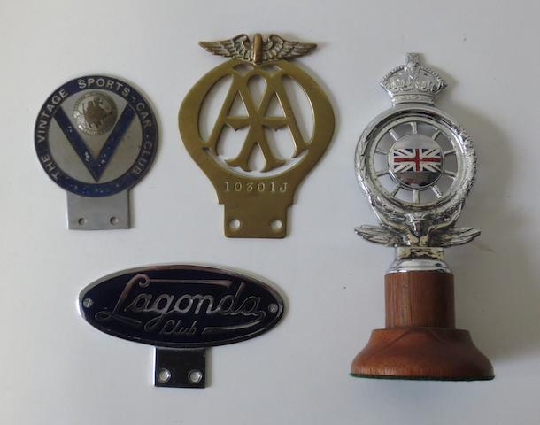 Four car badges,