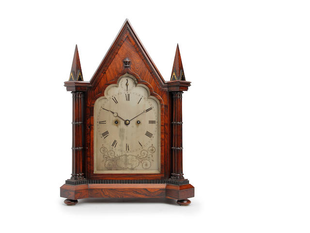 An impressive architectural Regency brass inlaid rosewood mantel clock in the Gothic style  John B Cross, London