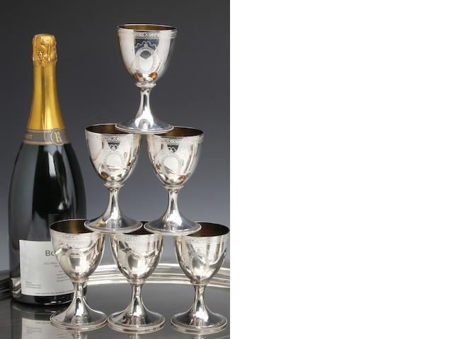 A silver set of six bright-cut goblets by C.J.Vander, London 1969
