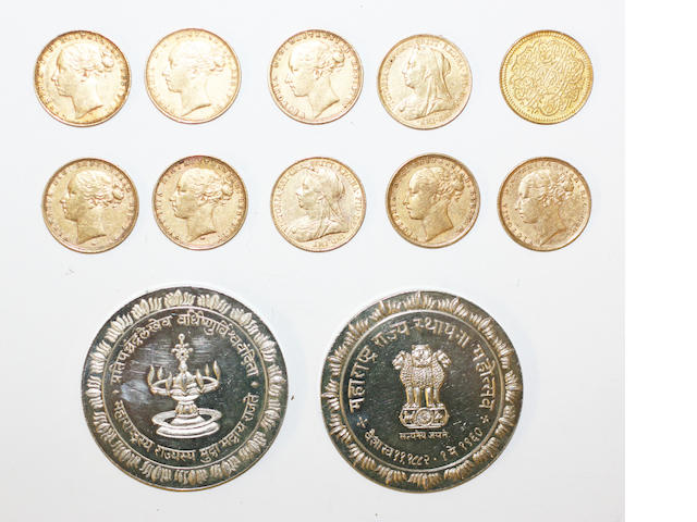 A group of 9 sovererigns and a gold Arabic coin and two silver coins,