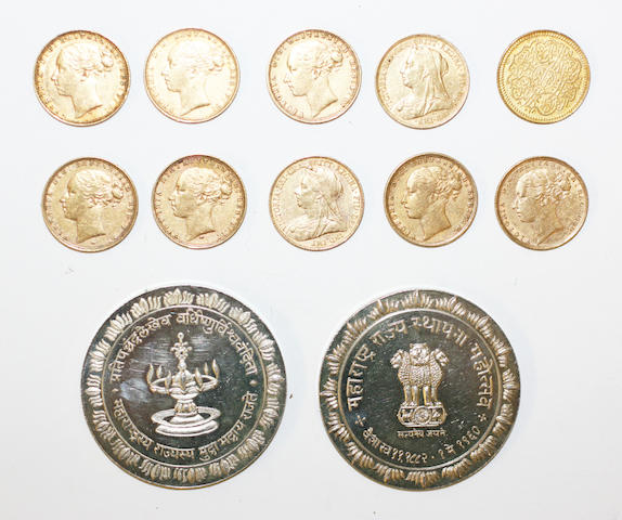 A group of nine sovererigns and a gold Arabic coin and two silver coins,