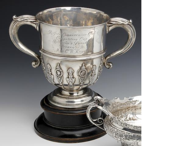 An Edwardian silver presentation twin-handled trophy cup by Walker & Hall, Sheffield 1909
