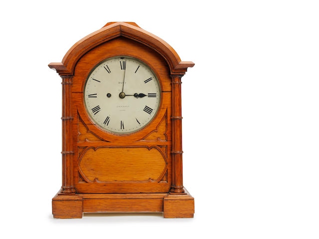 A 19th century oak Gothic style mantle clock  Dent, London