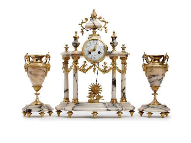 A 19th century French ormolu and marble portico clock garniture The movement by A D Mougin.