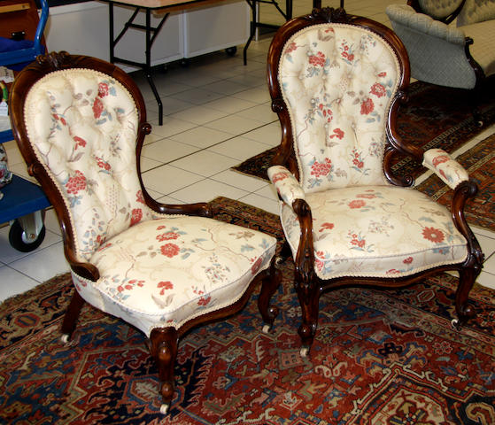 A Victorian walnut gentleman's open armchair and matching ladies chair