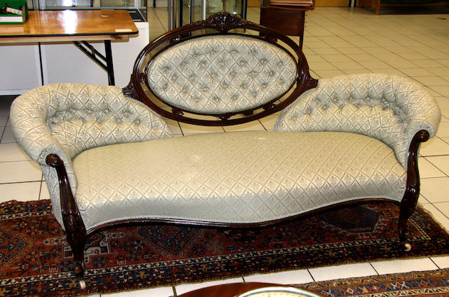 A Victorian walnut button back settee
