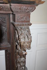 A large carved oak chimneypiece Third quarter 19th century