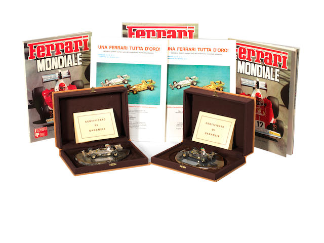 Two 1:43 scale model Ferrari 312 T Formula 1 cars in solid silver by Michele Conti, 1975