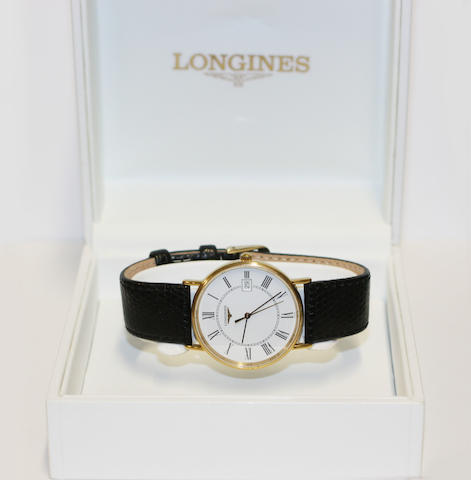Longines: A plated quartz wristwatch in original case