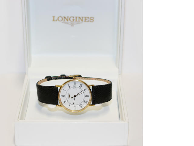 Longines. A gold plated quartz wristwatch together with box