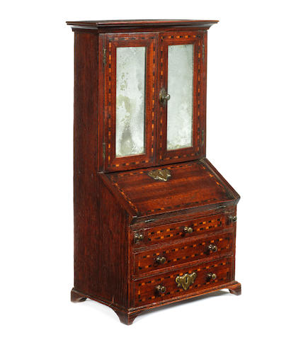 Miniature Furniture: A George II mahogany and chequerbanded bureau bookcase