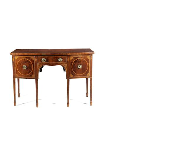 A George III mahogany and inlaid bow-front sideboard