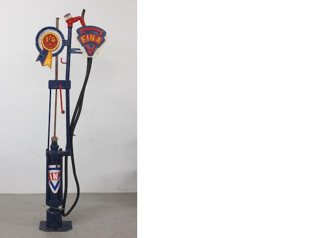 A skeleton-type hand-cranked petrol pump,