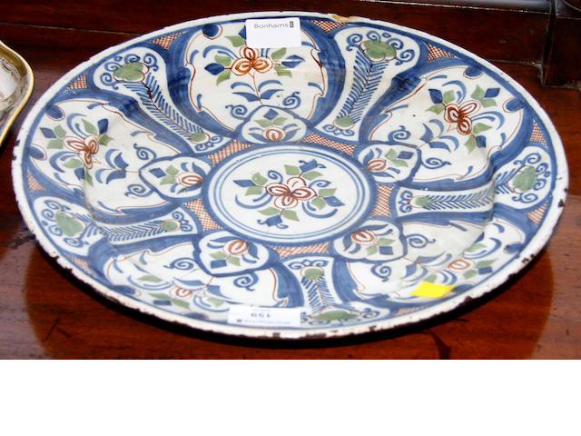 An 18th Century Delftware tin glazed pollychrome plate,