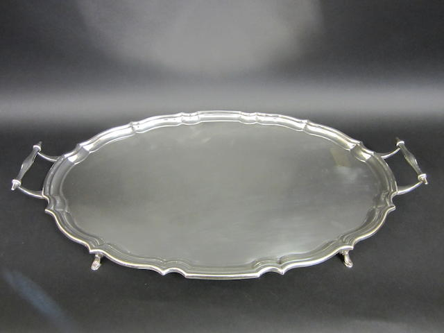 A silver twin handled tray by Barker Brothers, Chester 1923