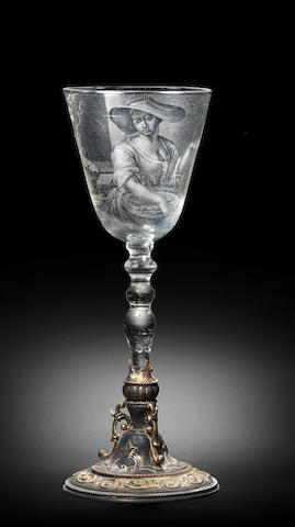 A fine Dutch stipple-engraved light-baluster goblet by Frans Greenwood, on a metal mount, circa 1744
