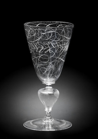 A fine Dutch façon de Venise diamond-point engraved calligraphic goblet, signed and dated by Willem van Heemskerk, 1686