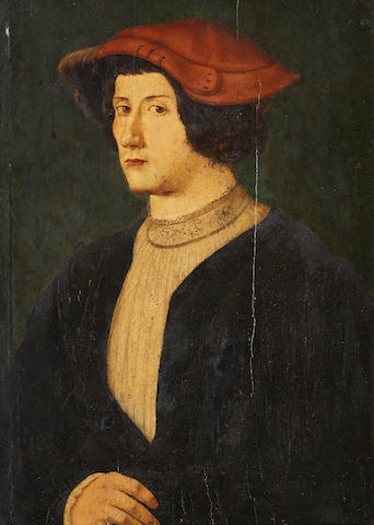 Circle of Hans Wolf (Bamberg -died 1542) Portrait of a young man, bust-length, in a brown tunic, a w