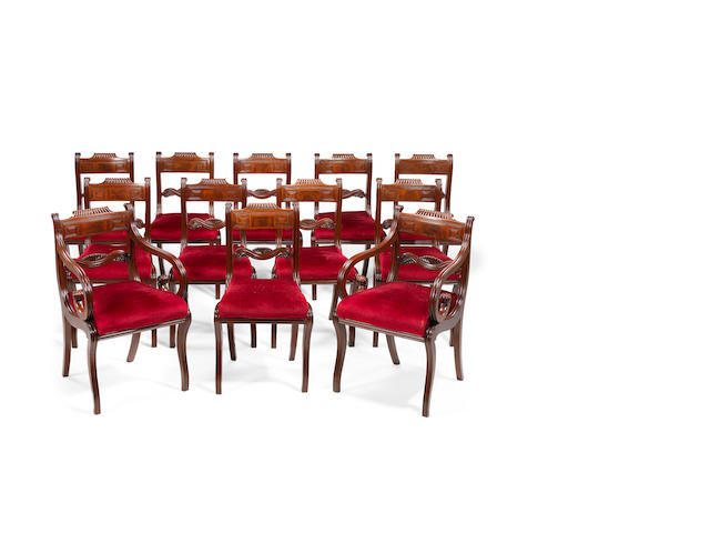 A set of twelve late Regency mahogany dining chairs, to include two elbow chairs Probably Scottish, including a pair of open armchairs