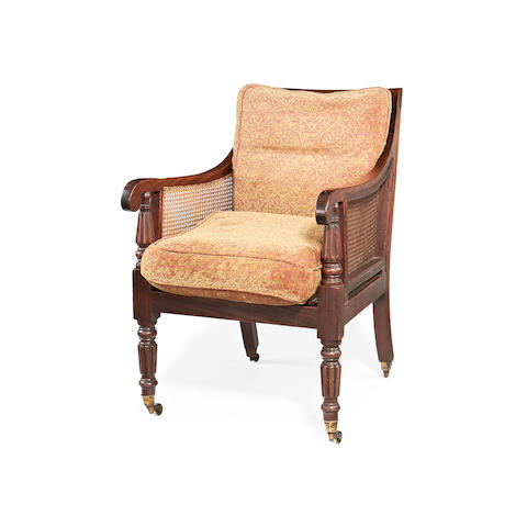 A William IV mahogany caned library bergere