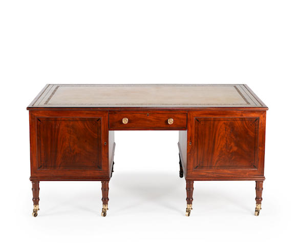 A Regency mahogany partners desk by Wilkinsons