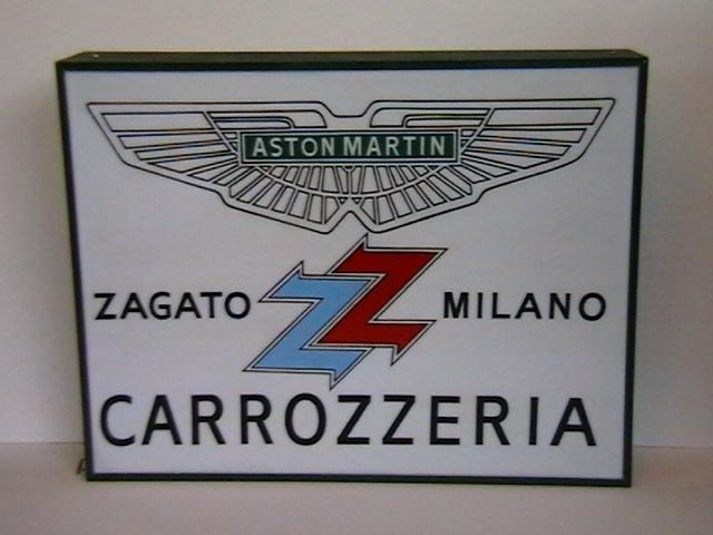 An Aston Martin Zagato Milano Carrozzeria illuminating sign,