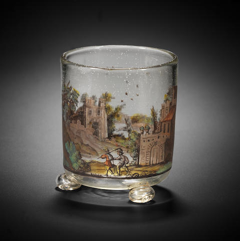 A Nuremberg polychrome Schwarzlot enamelled triple-bun footed beaker, possibly by Johann Schaper or Johann Faber, circa 1680