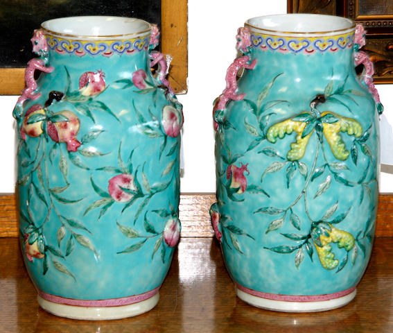 A pair of late 19th Century Chinese famille rose vases,