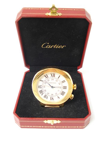 A travelling alarm clock, by Cartier