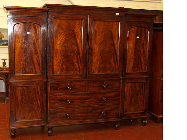 A figured mahogany breakfront wardrobe, 2nd quarter 19th century