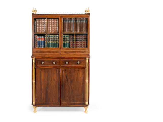 A Regency rosewood and parcel gilt side cabinet