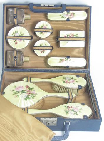 A silver and enamel mounted cased vanity set by Garrard & Co, London 1954