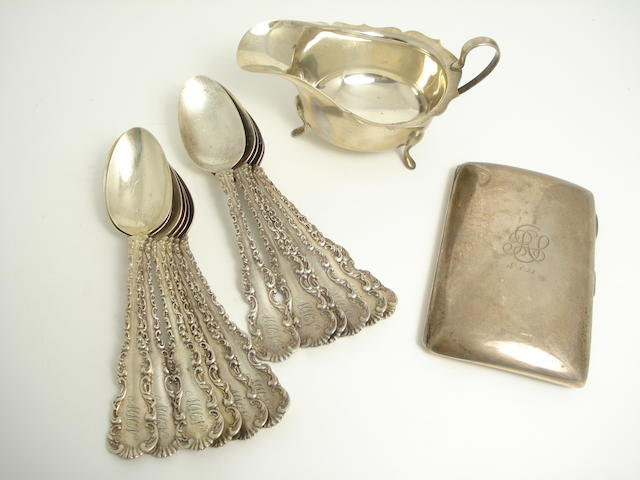 A set of twelve American dessert spoons by Whiting Manufacturing Company, a silver sauceboat and a cigarette case (3)