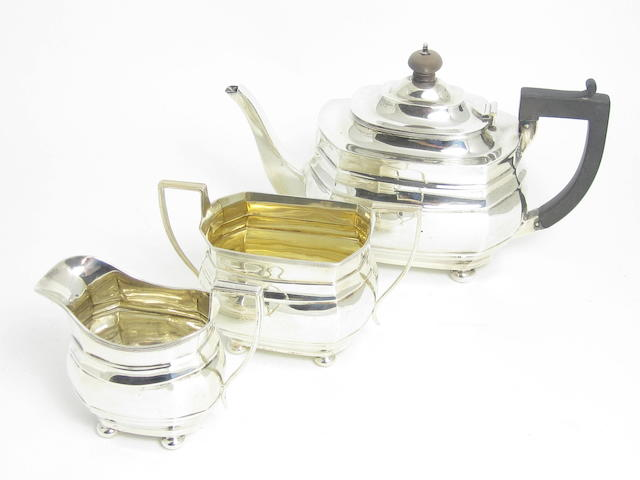 A three piece silver tea service by S.Blanckensee & Sons Ltd, Birmingham 1918