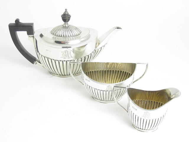 A three piece bachelor's silver tea service by J.Round, Sheffield 1897