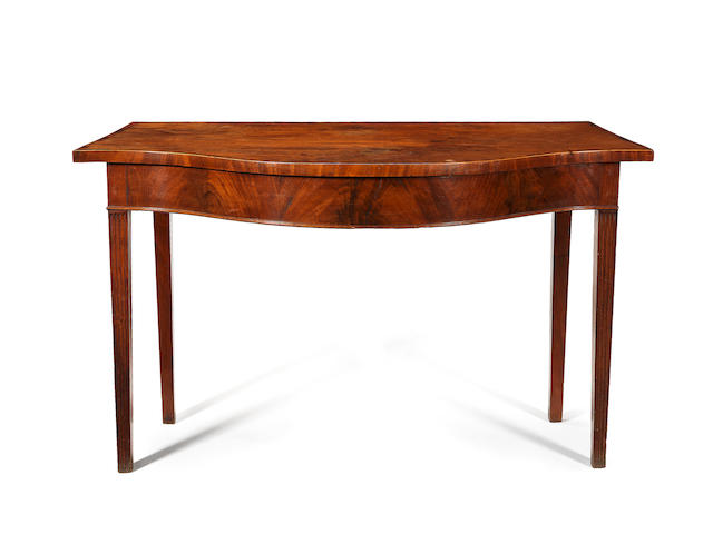 A George III mahogany and rosewood crossbanded serpentine serving table