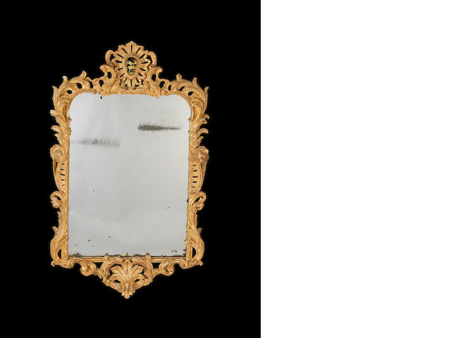 A George II carved giltwood mirror in the manner of Matthias Lock???