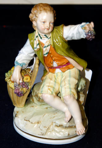 A Berlin KPM porcelain figure of a fruit picker