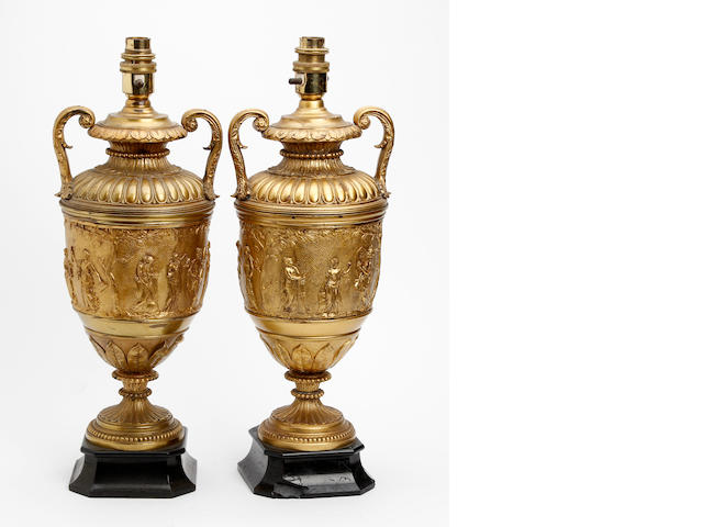 A pair of gilt metal table lamps