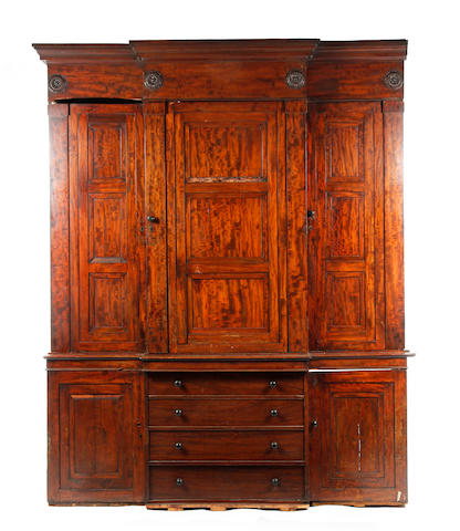 A 19th century mahogany breakfront library cabinet, in need of restoration