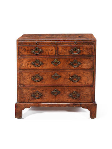 A George I burr walnut crossbanded and featherbanded bachelor's chest