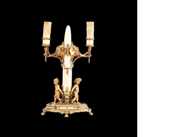 A French late 19th/ early 20th century ivory and gilt bronze mounted twin barnch candelabra