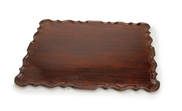 A George II-style mahogany dished pie-crust tray