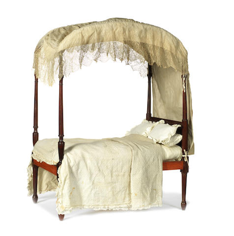MINIATURE FURNITURE: A late George III mahogany doll's tester bed