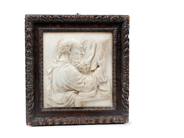 A relief carved marble plaque of a scholar