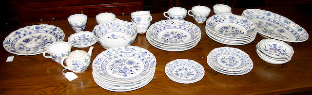 A collection of Meissen blue onion pattern breakfast, tea and dinner wares.