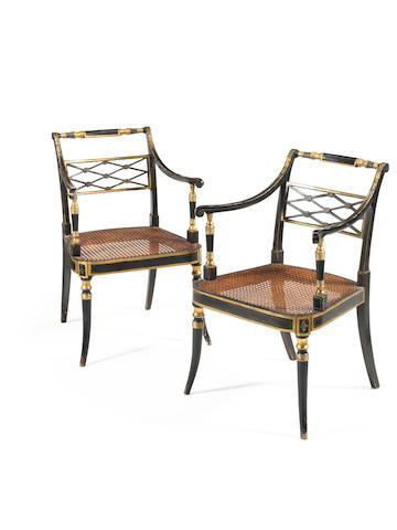 A pair of Regency ebonised and parcel gilt open armchairs by John Gee