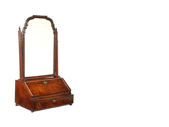 A large Queen Anne walnut, crossbanded and featherbanded toilet mirror